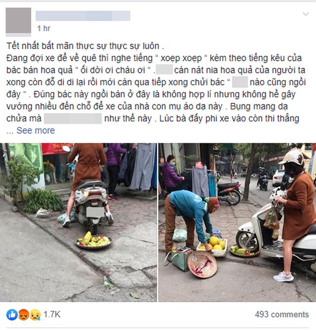 Xôn xao chuyện người phụ nữ cố tình chèn xe vào mẹt hoa quả của bà hàng rong - 1