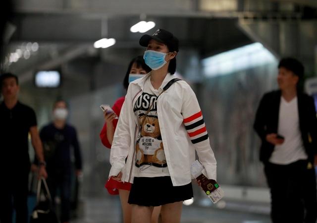 Châu Á đón Tết Âm lịch trong nỗi lo về dịch viêm phổi lạ - 7