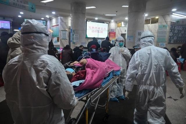 """Cảnh tượng như """"ngày tận thế"""" ở vùng tâm dịch viêm phổi lạ của Trung Quốc - 2"""