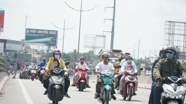 Người dân miền Tây đổ về Sài Gòn sau Tết - 5
