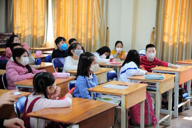 Đại dịch virus Corona: Hà Nội yêu cầu giáo viên, học sinh bị sốt đều phải nghỉ - 1