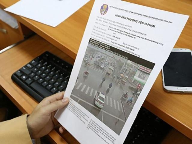 Người vi phạm quy định giao thông sẽ được nộp phạt tại nhà - 1