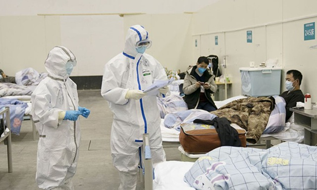 """Thành phố Trung Quốc dùng biện pháp """"thời chiến"""" ngăn chặn virus corona - 1"""