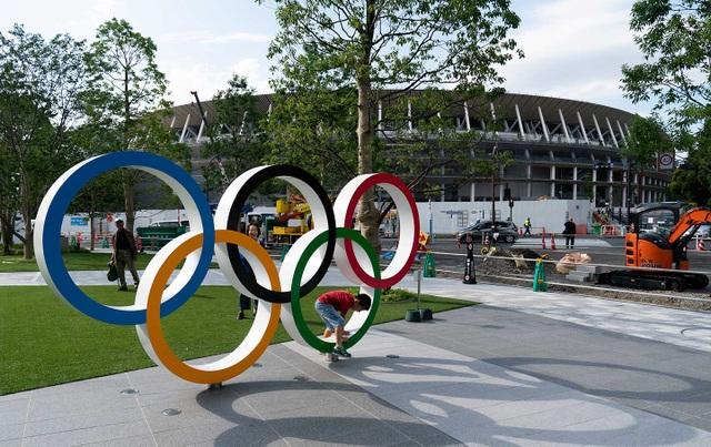 Nhật Bản tuyên bố chưa tính chuyện hoãn Olympic 2020 vì virus corona - 1