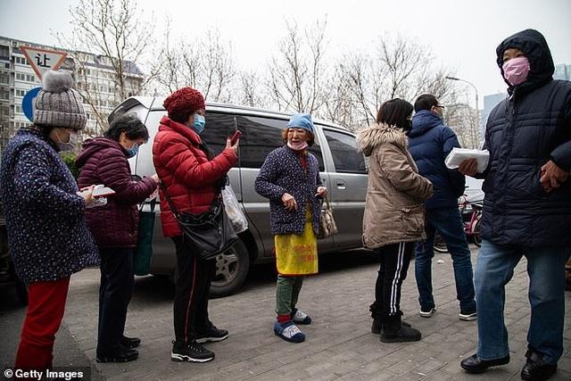Dân Trung Quốc vẫn ồ ạt đi du lịch bất chấp dịch Covid-19 đang hoành hành - 5