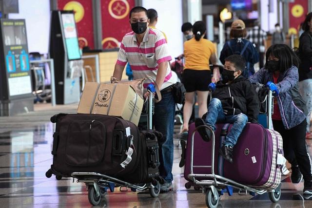 Bệnh nhân Trung Quốc nhiễm corona đối mặt án tù ở Singapore vì khai báo sai - 1
