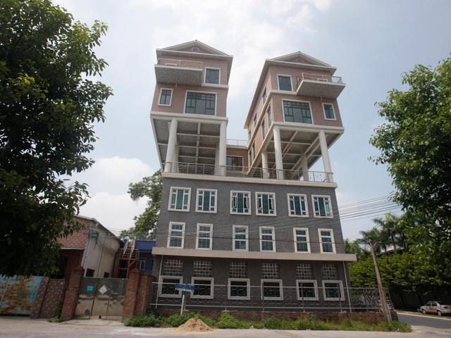 Kỳ lạ những ngôi nhà được xây dựng ở nơi không ai nghĩ đến - 7