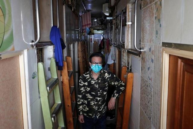 """Ám ảnh cuộc sống của cư dân nghèo trong nhà """"quan tài"""" tại Hồng Kông - 3"""