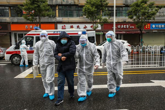 Số ca nhiễm mới virus corona ở Trung Quốc giảm kỷ lục - 1