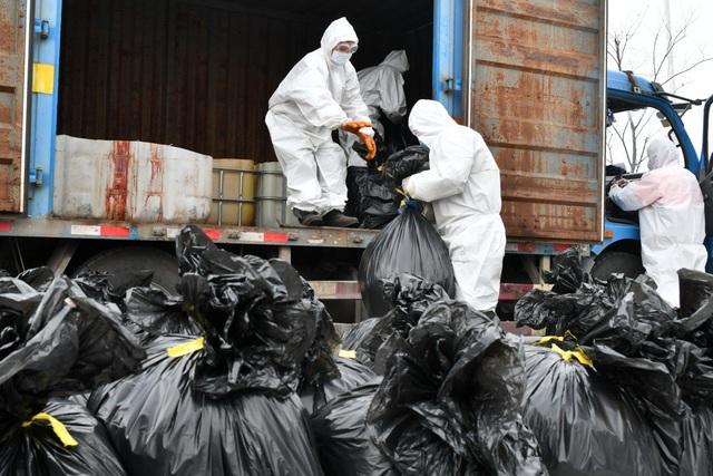 """Trung Quốc: Lo ngại """"thảm họa"""" sinh thái vì chất thải y tế Covid-19 - 1"""