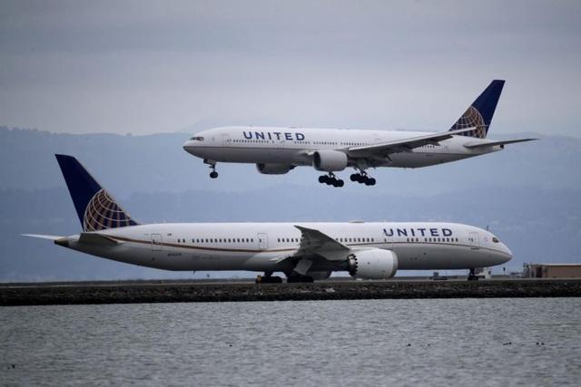 Máy bay quay đầu vì hành khách ho và hắt hơi - 1