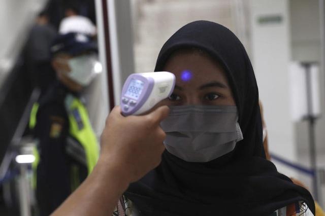 Indonesia có ca tử vong đầu tiên vì virus corona - 1