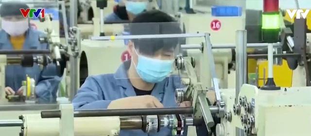 Làn sóng giảm mạnh lương tại các doanh nghiệp Trung Quốc - 1