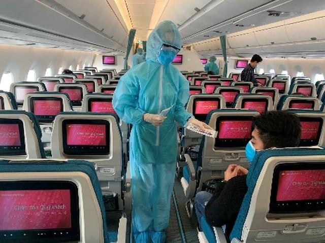 Khách đi máy bay phải giãn cách tối thiểu 2m để né dịch Covid-19 - 1