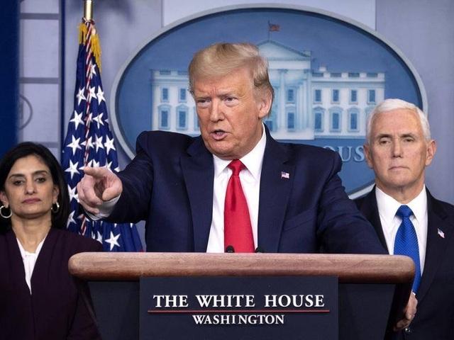 Số ca Covid-19 ở Mỹ lên gần 8.000, ông Trump kích hoạt luật thời chiến - 1