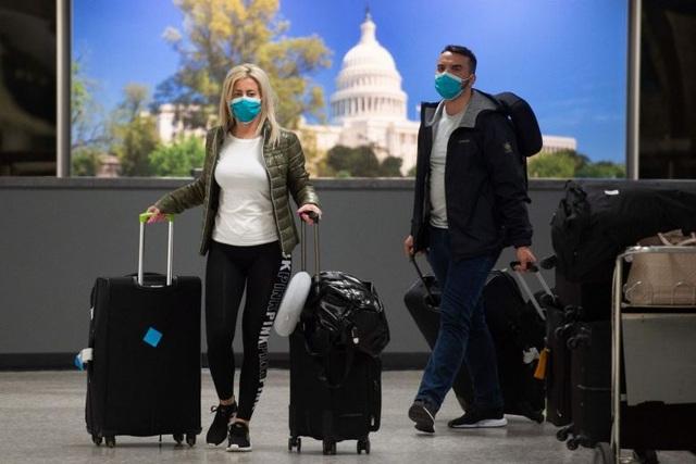 Mỹ dừng cấp thị thực trên toàn thế giới vì Covid-19 - 1