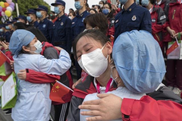 Trung Quốc: Ca nhiễm rồi không nhiễm virus corona ở Vũ Hán gây lo ngại - 1