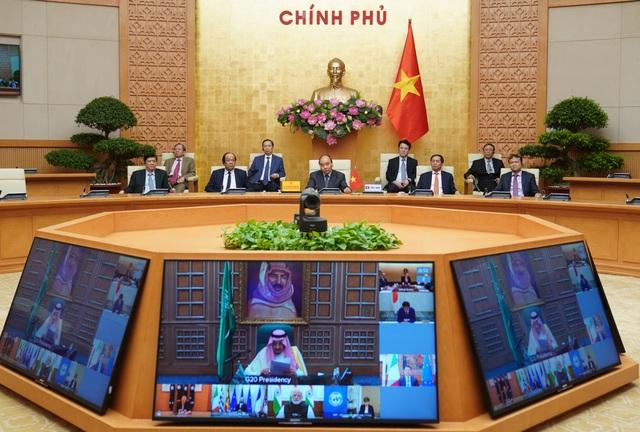 Thủ tướng họp thượng đỉnh trực tuyến G20, chia sẻ quyết tâm chống Covid-19 - 1