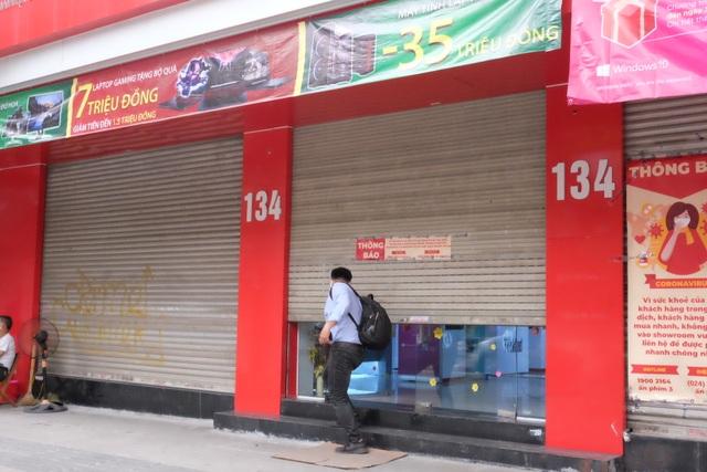 Hà Nội: Cửa hàng điện thoại ngừng kinh doanh, khó khăn nối tiếp khó khăn - 7