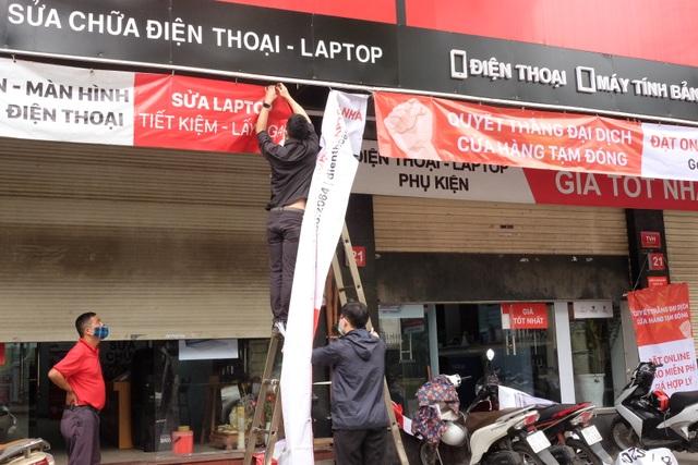 Hà Nội: Cửa hàng điện thoại ngừng kinh doanh, khó khăn nối tiếp khó khăn - 6