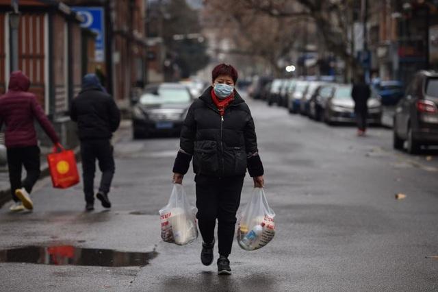 Trung Quốc tiếp tục phải đối mặt với cú sốc kinh tế sau đại dịch Covid-19 - 1