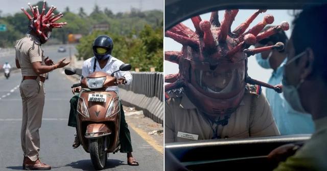 """Cảnh sát đội """"mũ bảo hiểm corona"""" cảnh báo người dân không ra đường - 1"""