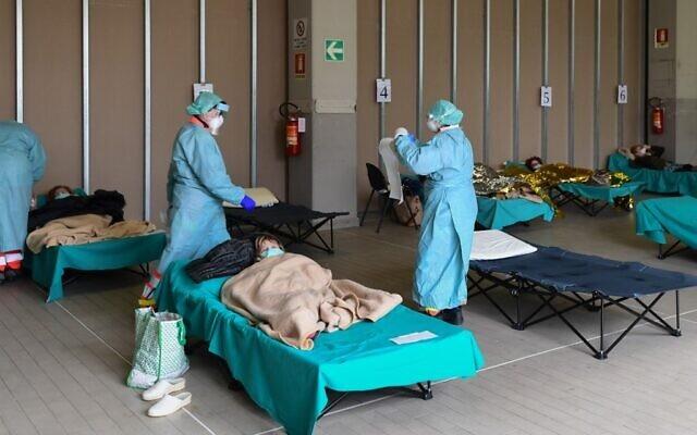 Vì sao hệ thống y tế bậc nhất thế giới của châu Âu vỡ trận vì Covid-19 - 3