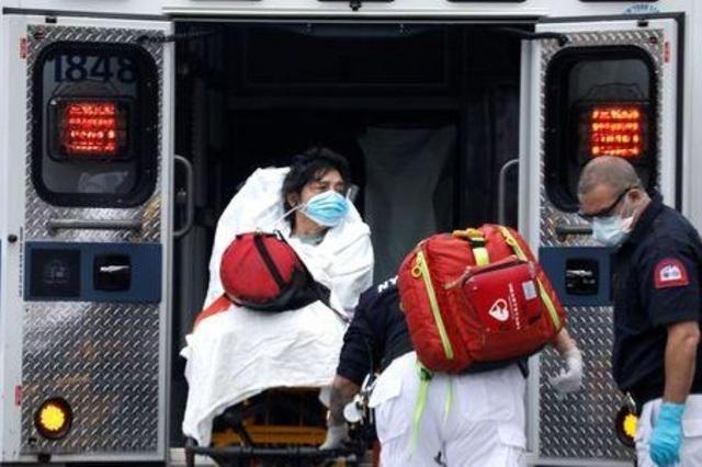 Thêm gần 2.000 người chết vì Covid-19, số ca tử vong tại Mỹ vượt 14.000 - 1