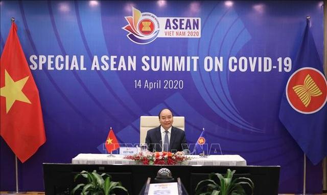 Thủ tướng: ASEAN cùng kề vai vượt qua khó khăn trong đại dịch COVID-19 - 1
