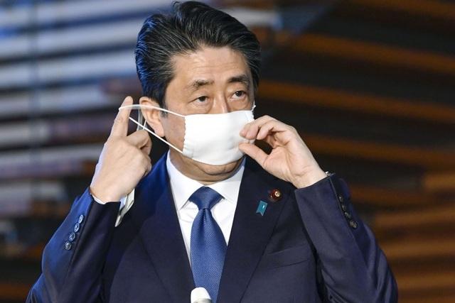 Hơn 9.000 ca mắc Covid-19, Nhật ban bố tình trạng khẩn cấp toàn quốc - 1