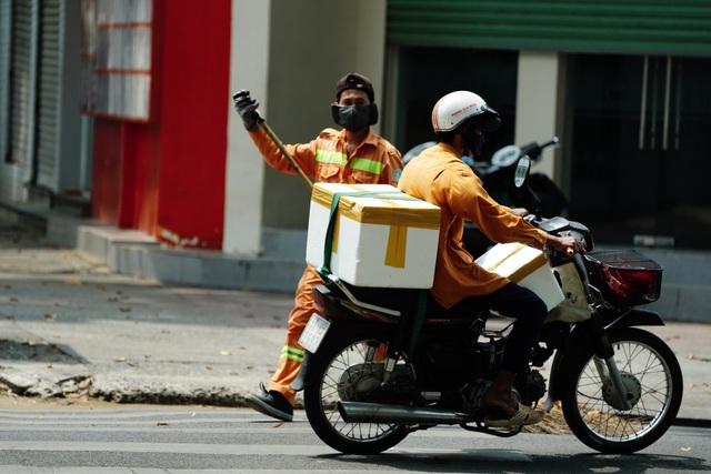 Người bán hàng rong, quét rác vui vì sẽ được hỗ trợ từ gói 62.000 tỷ đồng - 3