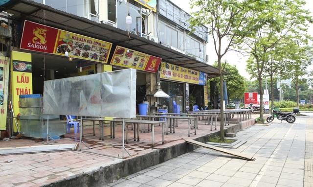 Hà Nội: Các cơ sở kinh doanh tất bật dọn dẹp để mở cửa trở lại - 12