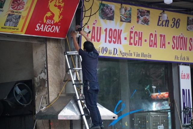 Hà Nội: Các cơ sở kinh doanh tất bật dọn dẹp để mở cửa trở lại - 6