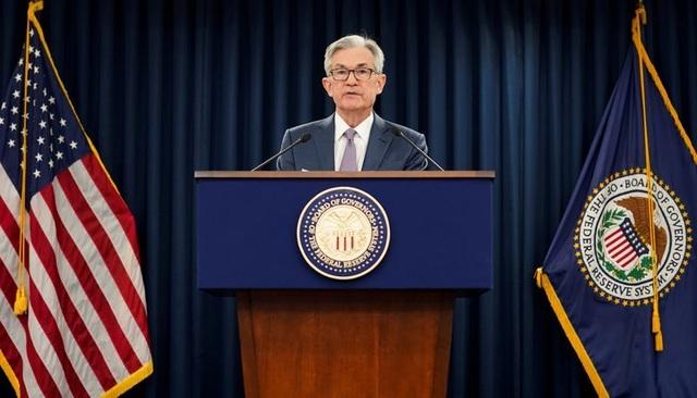 """Fed: Nền kinh tế Mỹ một lần nữa đối mặt với """"cú đấm mạnh"""" từ đại dịch - 1"""