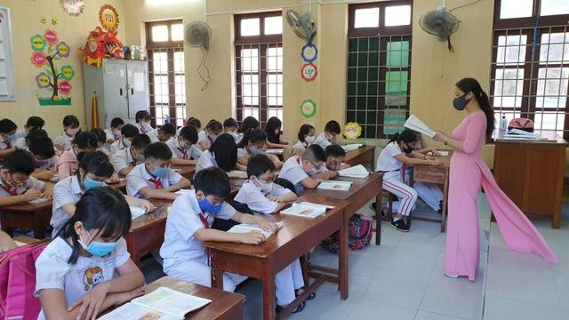 Hàng triệu học sinh đi học trở lại, nhà trường tích cực phòng ngừa dịch - 16