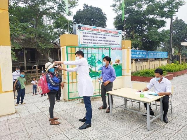 Hàng triệu học sinh đi học trở lại, nhà trường tích cực phòng ngừa dịch - 1