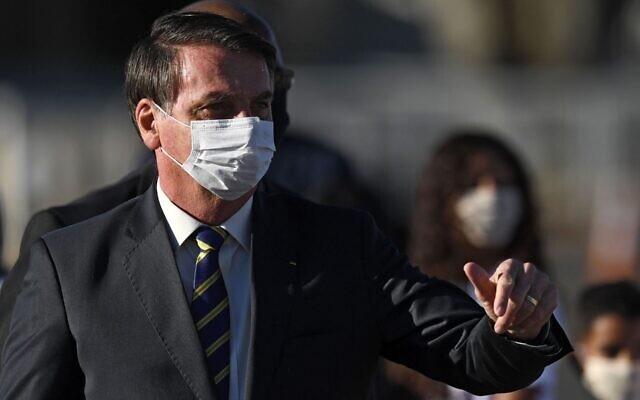 Brazil ghi nhận kỷ lục ca tử vong, Tổng thống tuyên chiến với thống đốc - 2