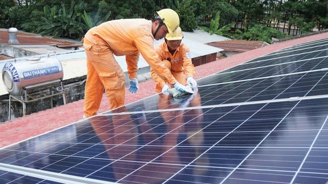 EVNSPC tăng cường hợp tác phát triển điện mặt trời áp mái - 1