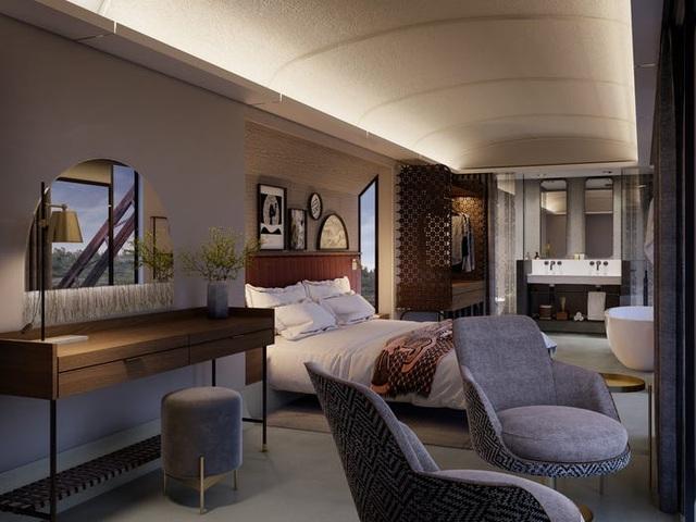 Kỳ lạ: Khách sạn nằm chênh vênh trên đường ray của cầu sắt - 6