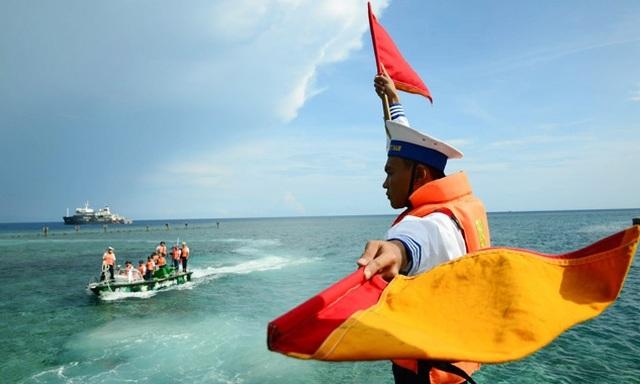 Bộ Quốc phòng: Trung Quốc không từ bỏ tham vọng độc chiếm Biển Đông - 1