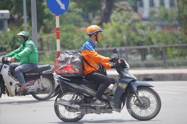 Hà Nội: Người lao động nhọc nhằn mưu sinh dưới nắng nóng đầu hè - 3