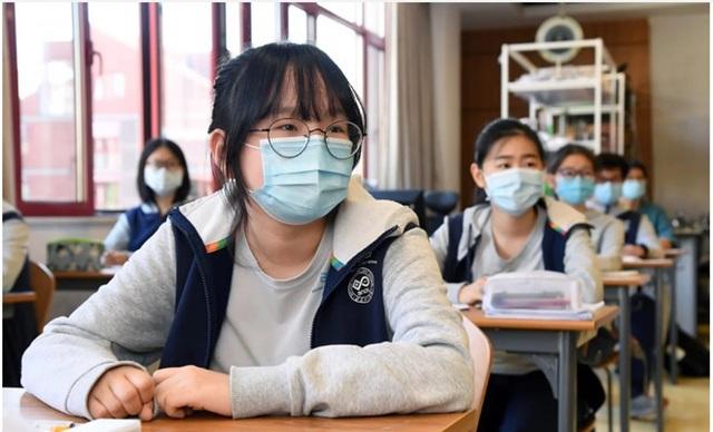 Trung Quốc cấm giáo viên dạy trước chương trình - 1