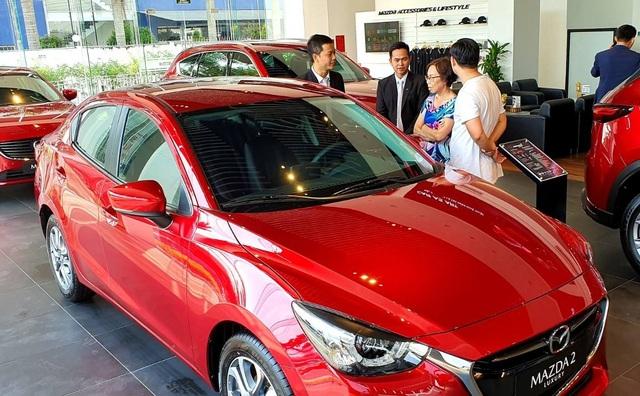 Ô tô nhập giảm giá hàng trăm triệu đồng, xe nội cắt khuyến mại, tăng giá - 4