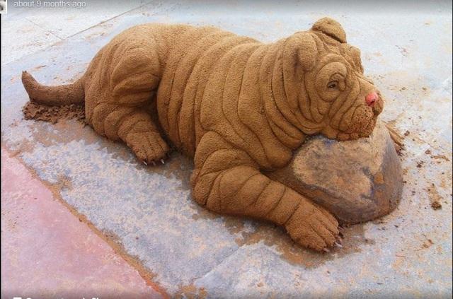 Hút mắt những tác phẩm điêu khắc siêu thực trên cát - 5