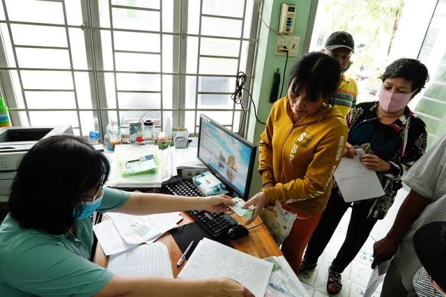 80.000 lao động tự do đã nhận tiền hỗ trợ từ gói an sinh 62.000 tỷ đồng - 6