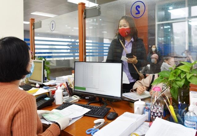Hà Nội đẩy mạnh chi trả lương hưu, trợ cấp BHXH qua tài khoản cá nhân - 1
