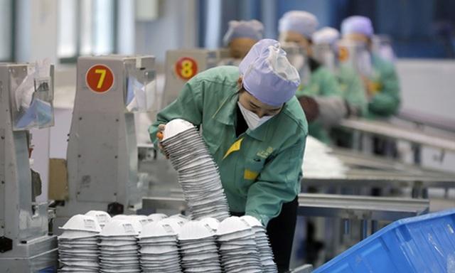 Mỹ khuyến cáo không tái sử dụng khẩu trang Trung Quốc - 1