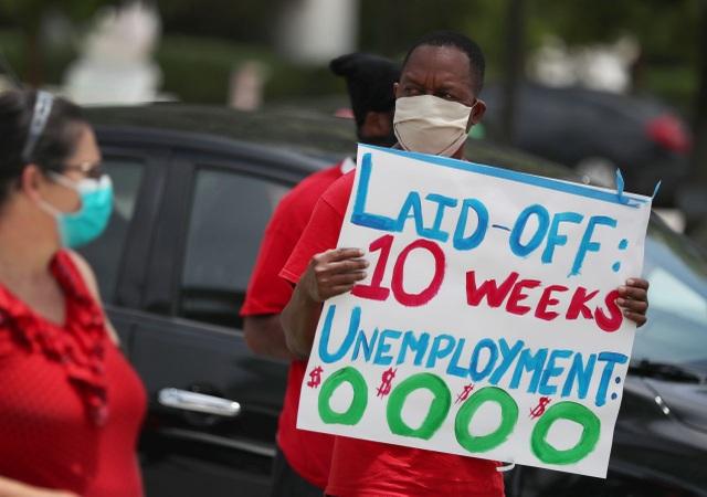 Nhà giàu Mỹ hạn chế chi tiêu, người lao động tiếp tục thất nghiệp - 1