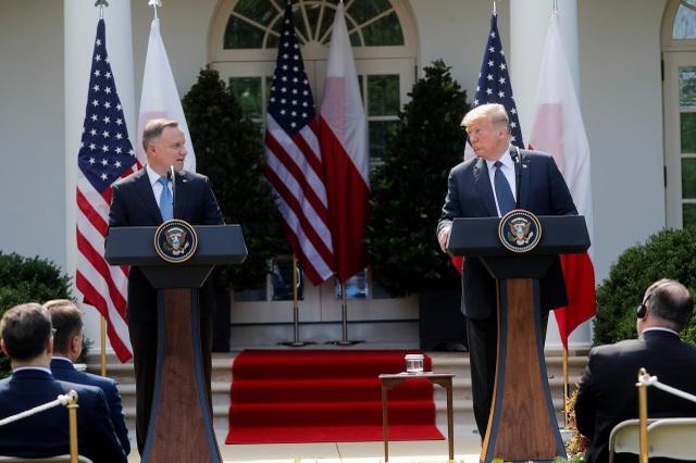 """Ông Trump muốn """"nắn gân"""" Nga khi điều quân từ Đức tới Ba Lan - 1"""