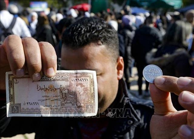 Hơn 90% dân số Syria sống với thu nhập chưa đến 2 USD/ngày - 1